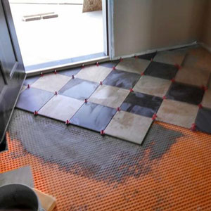 Checker board tile pattern with the ATR Tile Leveling System cross and edge spacing plate.