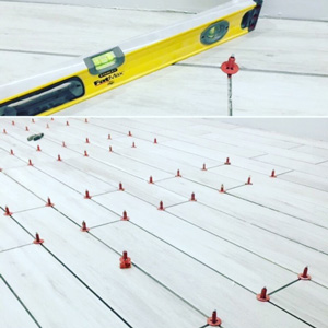 The spirit level reveals the elimination of lippage using the ATR system resulting in superior, level tiling.