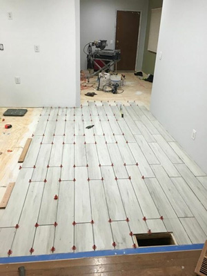 Offset or brick pattern tile installation. The ATR spindle is removed once tile adhesive is dry